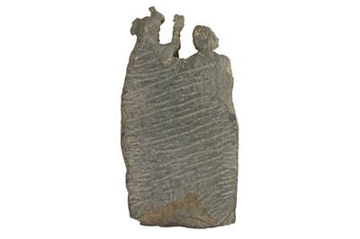 Lot 174 - A GREY SCHIST CARVING WITH A STANDING PAIR