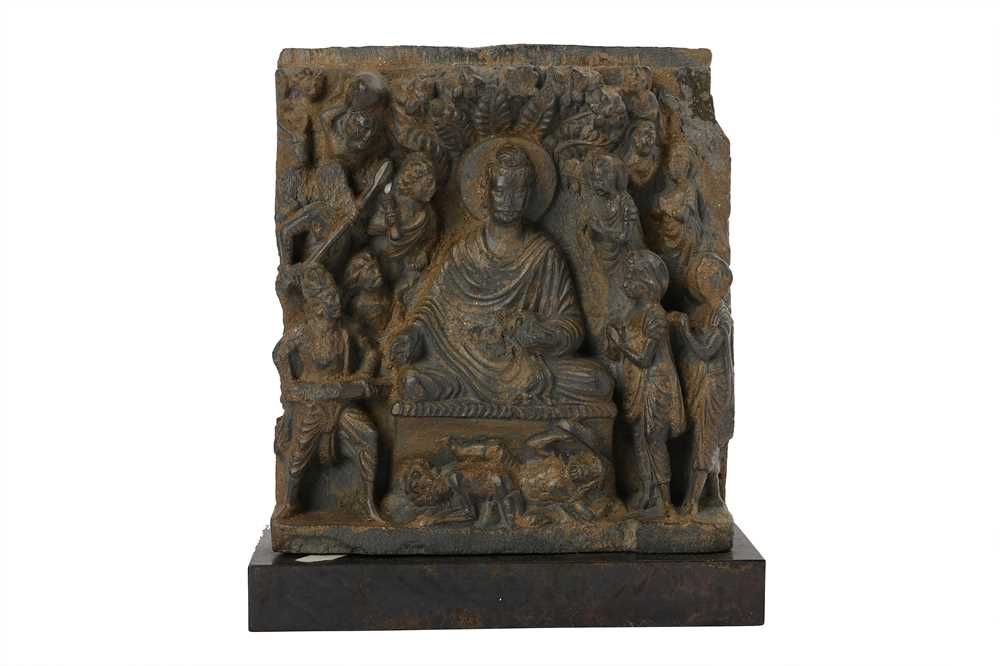 Lot 150 - A GREY SCHIST RELIEF OF THE BUDDHA BEING ATTACKED BY MARA