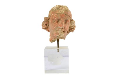 Lot 108-A SMALL RED-PAINTED STUCCO BODHISATTVA HEAD