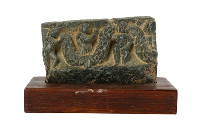 Lot 106-A SMALL GREY SCHIST FRIEZE RELIEF WITH GARLANDS AND CHERUBS