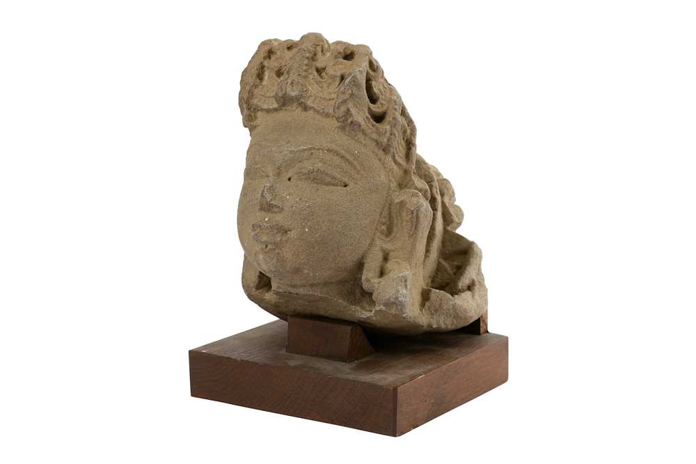 Lot 110-A BUFF SANDSTONE HEAD OF A GODDESS OR APSARA