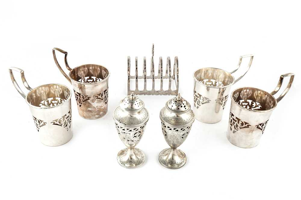 Lot 36-Two Edwardian Neo Classical sterling silver cruets