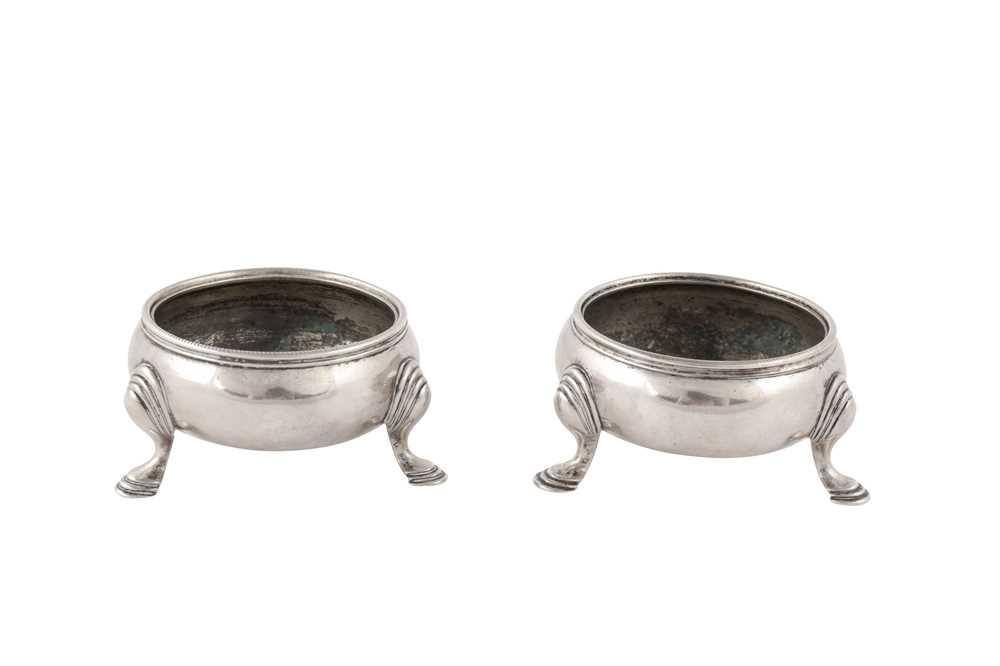 Lot 46-A pair of early George III Scottish sterling silver cauldron salts