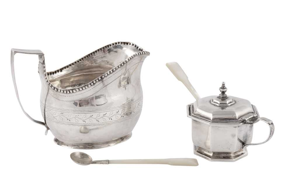 Lot 47-A George III sterling silver sauce boat