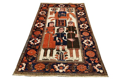 Lot 41-AN UNUSUAL BALOUCH PICTORIAL RUG, NORTTH-EAST PERSIA
