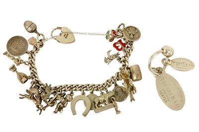 Lot 116-A key chain by Tiffany & Co. and silver charm bracelet