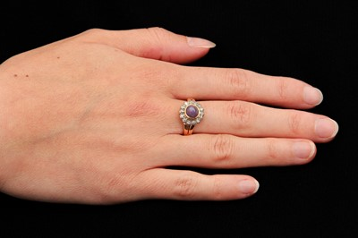 Lot 13-A purple star sapphire and diamond cluster ring, 1964