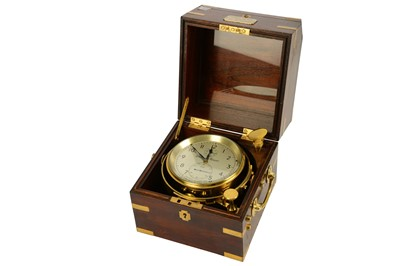 Lot 46-A 20TH CENTURY BRASS MARINE CHRONOMETER BY THOMAS MERCER