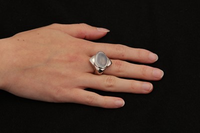 Lot 30-A moonstone ring and earclips, by Boodle & Dunthorne