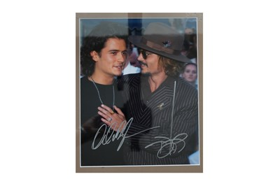 Lot 85-Depp (Johnny) & Orlando Bloom