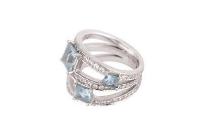 Lot 28-An aquamarine and diamond ring, retailed by Ritz Fine Jewellery