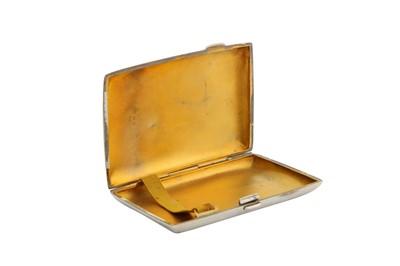 Lot 8-An Edwardian sterling silver cigar case, Birmingham 1909 by Samuel M Levi