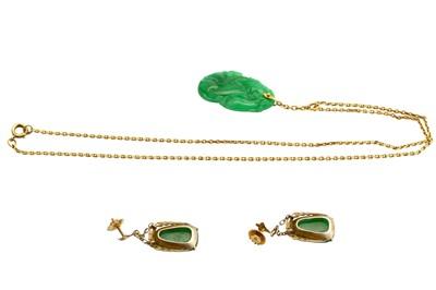 Lot 33-A jade pendant and a pair of jade earrings