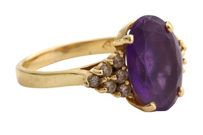 Lot 42-An amethyst and diamond ring