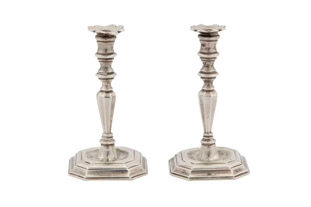 Lot 40-A pair of mid-18th century Dutch silver miniature 'toy' cast candlesticks, Amsterdam 1758 by Arnoldus Van Geffen (active 1728-69)