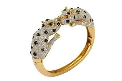 Lot 36-An onyx and diamond hinged bangle