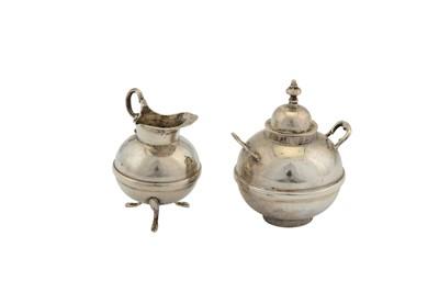Lot 39-A late 19th century Dutch silver miniature or 'toy' four-piece tea service, Groningen circa 1880