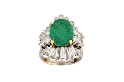 Lot 1227-An emerald and diamond cluster ring