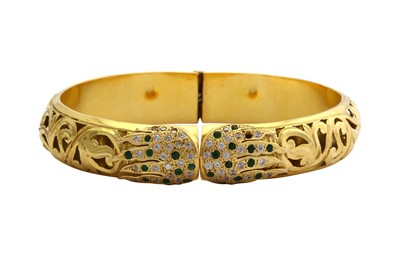 Lot 4-A gem-set hinged bangle