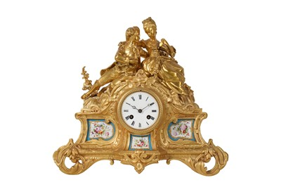 Lot 25-A LATE 19TH CENTURY FRENCH GILT BRONZE AND BLUE PORCELAIN FIGURAL MANTEL CLOCK