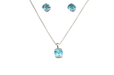 Lot 25-A blue topaz pendant necklace and earstuds