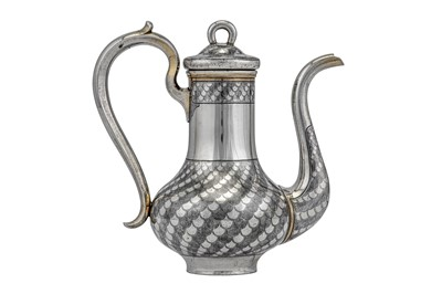 Lot 51-An Alexander II Russian 84 Zolotnik (875 standard) parcel gilt silver and niello bachelor coffee pot, Moscow 1867 by Alexey Osipov (active 1863-68)