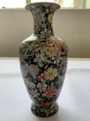 Lot 21-A CHINESE FAMILLE ROSE BLACK-GROUND 'MILLEFLEUR' VASE.