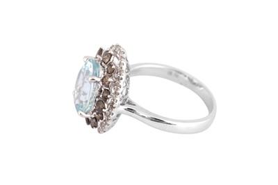 Lot 32-An aquamarine and diamond cluster ring