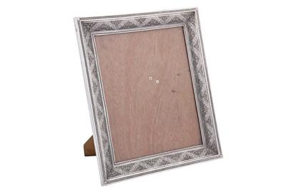 Lot 86-A mid-20th century Iranian (Persian) silver photograph frame, Isfahan circa 1960 mark of Bagher Parvaresh (c.1910-1978, master 1928)