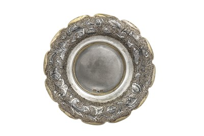 Lot 48-An Alexander II Russian provincial parcel gilt and niello 84 zolotnik (875 standard) silver saucer, circa 1860, makers mark obscured possibly MK