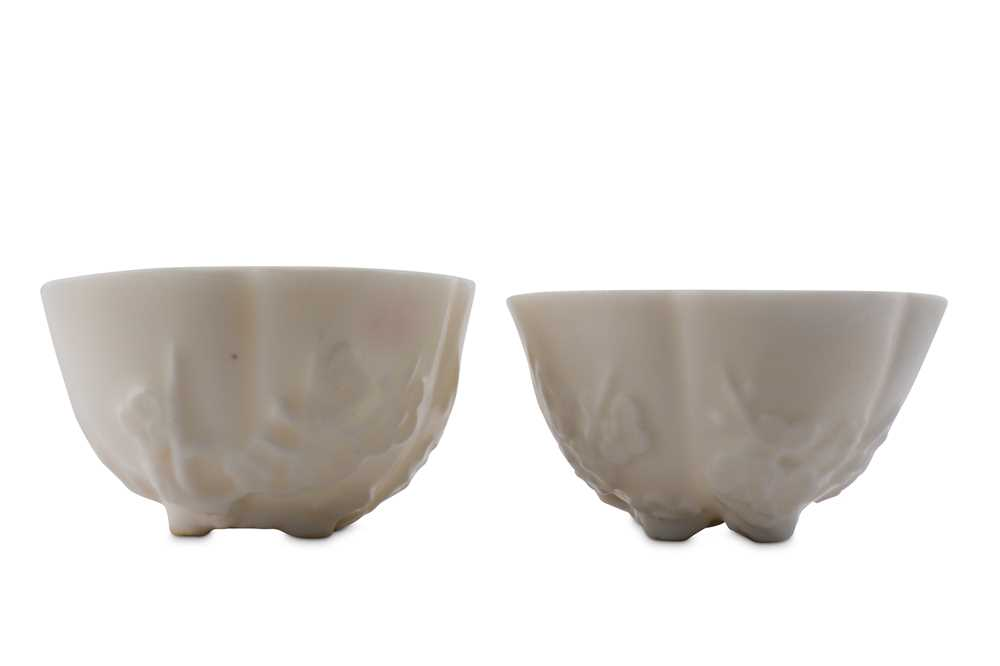 Lot 35-A PAIR OF CHINESE BLANC-DE-CHINE 'PRUNUS BLOSSOM' CUPS.