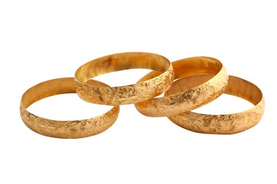 Lot 49-A collection of four bangles