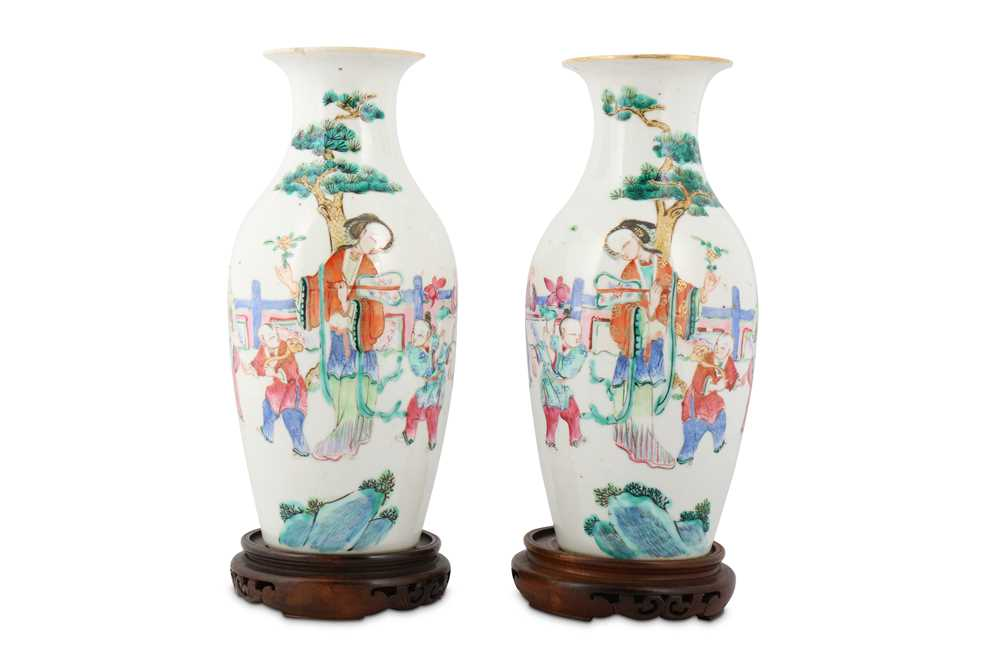 Lot 18-A PAIR OF CHINESE FAMILLE ROSE 'LADY AND BOYS' VASES.