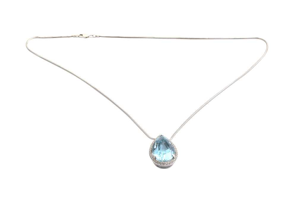 Lot 3-A topaz and diamond pendant