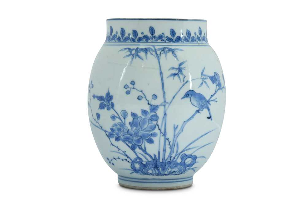 Lot 8-A SMALL BLUE AND WHITE 'BIRD AND FLOWER' JAR.