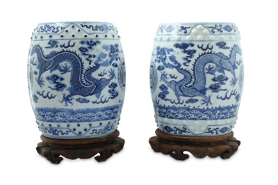 Lot 10-A PAIR OF BLUE AND WHITE MINIATURE GARDEN SEATS.
