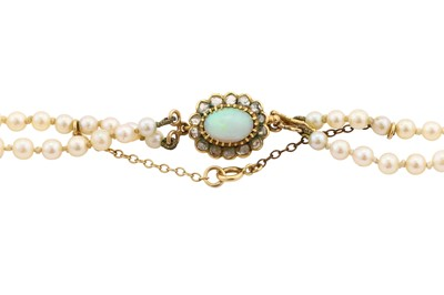 Lot 16-A double-strand cultured pearl necklace with an opal and diamond clasp