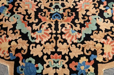 Lot 18-AN UNUSUAL CHINESE LARGE RUG