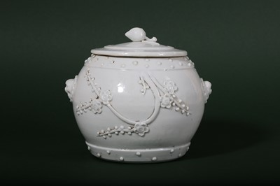 Lot 12-A CHINESE BLANC-DE-CHINE 'PRUNUS' JAR AND COVER.