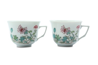 Lot 16 - A PAIR OF CHINESE FAMILLE ROSE COFFEE CUPS.