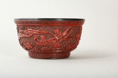 Lot 39-A CHINESE CARVED CINNABAR LACQUER 'BOYS' BOWL.