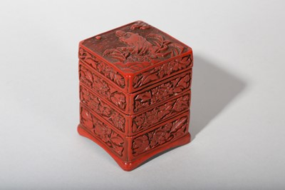 Lot 37-A CHINESE CINNABAR LACQUER THREE-TIERED BOX AND COVER.
