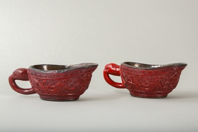 Lot 38-A PAIR OF CHINESE CINNABAR LACQUER POURING VESSELS, YI