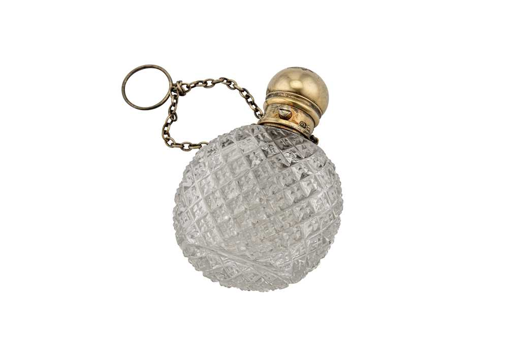 Lot 19-A Victorian silver gilt mounted cut glass scent bottle, London circa 1870 by George Brace (reg. Aug 1859)