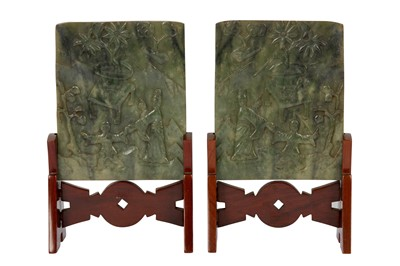 Lot 30 - A PAIR OF CHINESE GREEN JADE 'LADY AND BOY ' TABLE SCREENS.