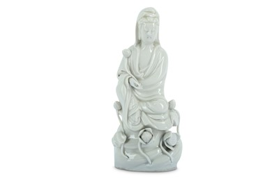 Lot 39-A CHINESE BLANC-DE-CHINE FIGURE OF GUANYIN.