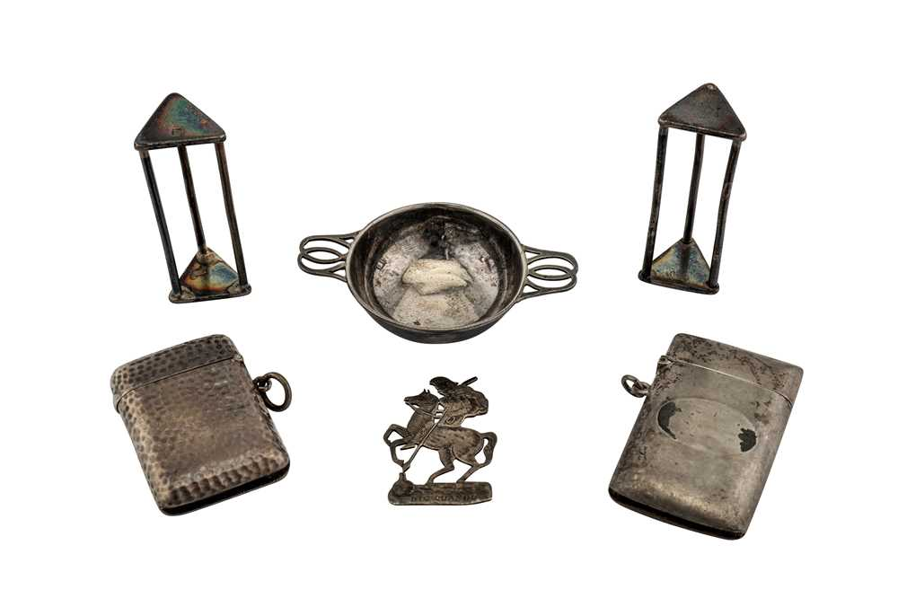 A mixed group of silver items including a pair of George III silver knife...