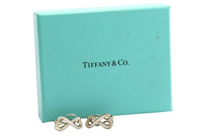 Lot 29-A pair of silver earrings by Paloma Picasso for Tiffany & Co