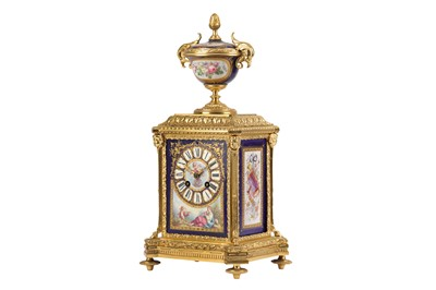 Lot 22-A THIRD QUARTER 19TH CENTURY FRENCH NAPOLEON III GILT BRONZE AND SERVES PORCELAIN MANTEL CLOCK