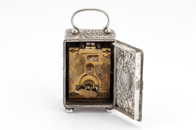 Lot 41-An Edwardian sterling silver cased travelling timepiece carriage clock, London 1905 by William Comyns